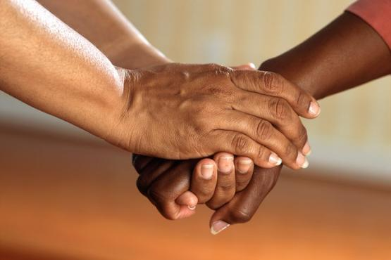 social care holding hands